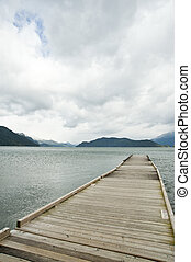 quiet lake - A wooden dock extended into the lake in a...
