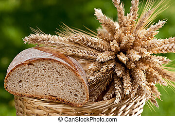 Bread and sheaf of wheat and barley - bread and sheaf of...