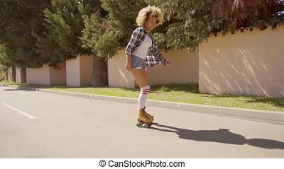 Young Woman On Roller Skates Enjoying The Summer