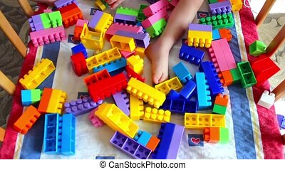 Children playing with colorful plastic blocks