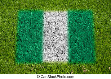 flag of nigeria on grass