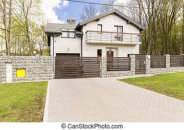 Perfect house for a big family - Shot of a white detached...