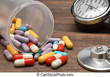 Medical Devices and Scattered From Vial Pills on Wooden...
