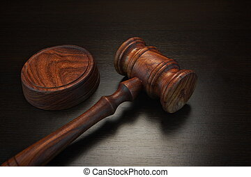 Real Judges Or Auctioneer Gavel On The Black Wooden Table -...