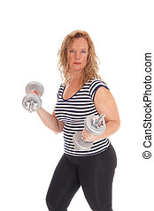 Woman workout with dumbbells - A strong middle age woman in...