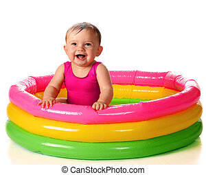 Kiddie Pool Delight - A delighted baby girl playing in a...