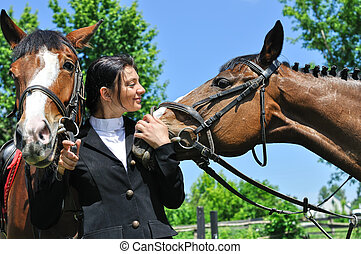 young horsewoman with two horse