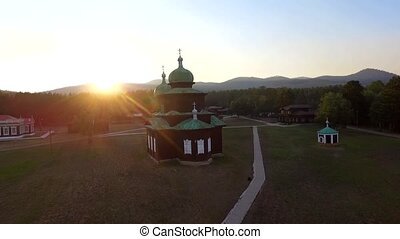 Church on the field on a sunny summer evening. An aerial...