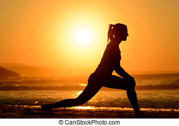 Yoga and relax on sunset - Woman practicing yoga, stretching...