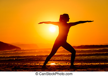Yoga and relax on beach  at sunset