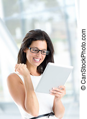 Successful reading on digital tablet - Successful woman...