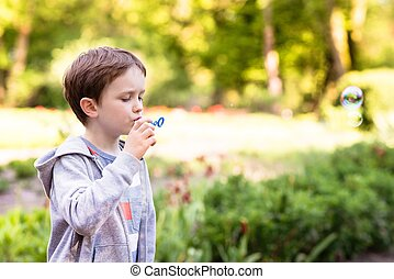 Little boy blowing soap bubbles - Children's Day Little...
