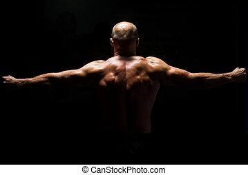 Back View OF A Muscular Man Praying