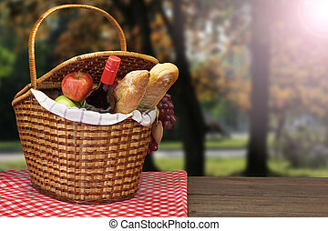 Picnic Basket With Food And Drink On The Wood Table -...