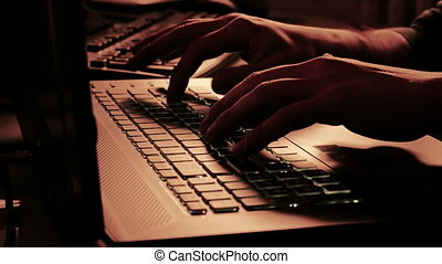 man typing on notebook keyboard with warm light tint, with...