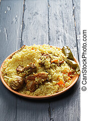 Pilaf with lamb on a wooden tabletop