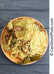Pilaf with lamb overhead - Pilaf with lamb on a wooden...