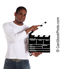 Man using slate - An attractive dark-skinned man using a...