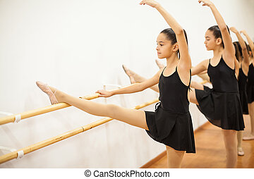 Beautiful girl practicing some ballet - Cute girl in a...