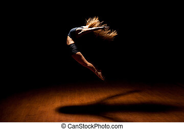 Beautiful dancer jumping in a stage - Full length profile...