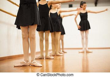 Little girls and teacher in a dance school