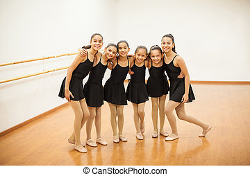 Happy little dancers in a ballet class - Full length...