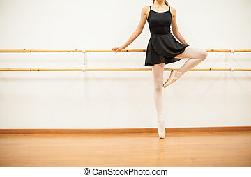 Female dancer standing on her toes