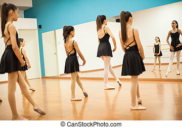 Girls learning a dance routine at school