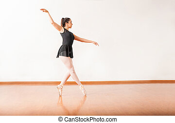 Ballet dancer walking on her toes