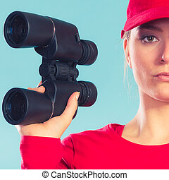 Lifeguard on duty supervising with binoculars - Lifeguard...