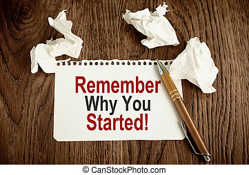 Remember Why You Started. Written on white paper on wooden...