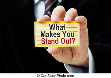 What Makes You Stand Out. Card in businessman hand