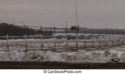 Airplane landing on a runway. - Airplane landing on a runway...