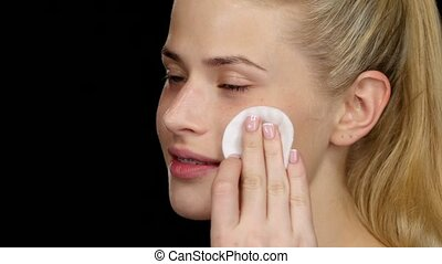 Cleaning skin. Black. Closeup - Cleaning skin, young...