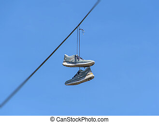Dangling Shoes - Shoes dangling on a cable over the street...