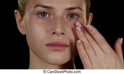 Moisturizing skin. Make up. Closeup - Moisturizing skin,...