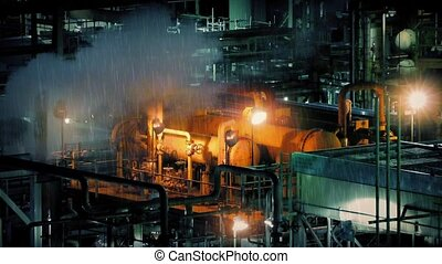 Industrial Machines Lit Up At Night - Industrial plant at...