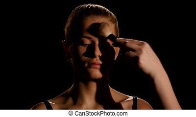 Professional face makeup for photo shooting. Black. Closeup...