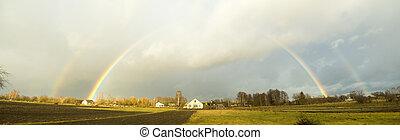 after autumn rain - rainbow in sky after autumn rain