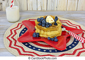 waffles on red star plate - Stack of waffles with...