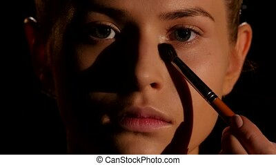Make-up for the young girl. Black. Closeup - Make-up for the...