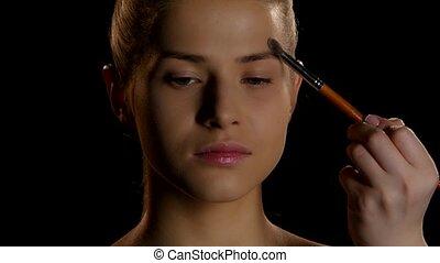 Makeup. Cosmetics. Makeup artist at work - Professional...