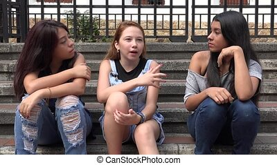 Teen Girls Talking And Sitting