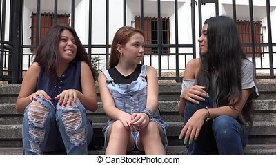 Teen Girls Sitting And Talking