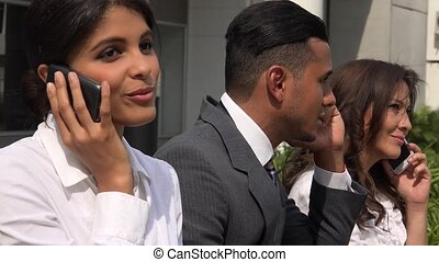 Business People Talking On Cell Phones