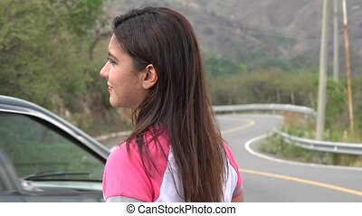 Woman Standing At Curved Mountain Road