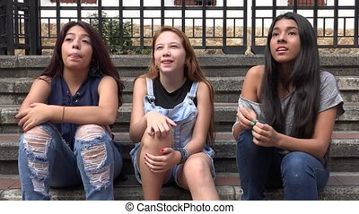 Teen Girls Listening And Laughing