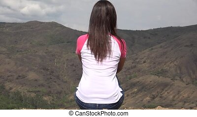 Woman Sitting With Mountain Vista