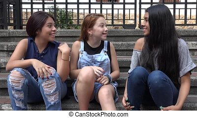 Excited Teen Girls Talking And Agreeing
