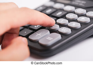 Using The Calculator - The man is using the black calculator...